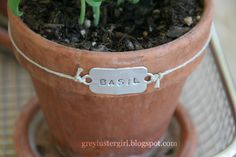 grey luster girl: DIY Pop Can Herb Tags    can you believe this is made from a soda can? so cool. makes me wanna go buy those metal stamping letters now :P