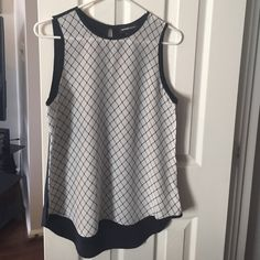 Sleeveless blouse Sleeveless blouse with high-low bottom, geometric print Fifteen twenty Tops Blouses