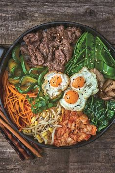 Bibimbap – Mixed Rice Bowl with Beef #Recipe... Bibimbap is a fantastic Korean #MainDish comfort food, packed with rice, vegetables and flavour. Judy Joo simplified her bibimbap recipe, making it quick and easy to prepare.