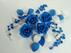 Edible Set Of Royal Blue Sugarpaste Roses for the wedding cake?
