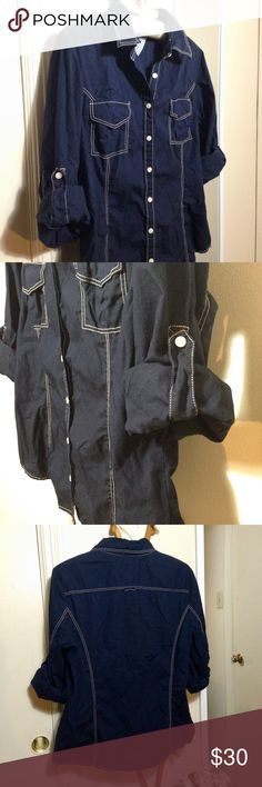 TOMMY HILFIGER Casual Button-up Fits M–L Navy blue w/ cream stitching. Buttons on mid-arms for easy roll-up sleeves. Front pockets have snap button closures. Fitted cut. Runs a bit small & would fit those on the medium/large border best. Great condition. Tommy Hilfiger Tops Button Down Shirts