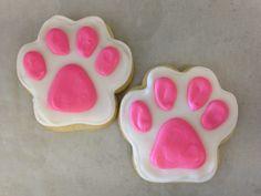Pink paw print sugar cookies.