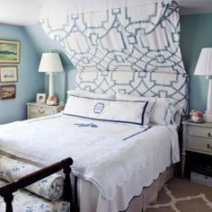 half canopy hanging from headboard over bed