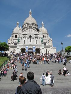 Sacre Coure basilica in Monte Montre, Paris.  A couple had just gotten married, so sweet!