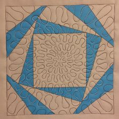The Free Motion Quilting Project: Josh's Wiggly Spirals in a Spinning Square Block