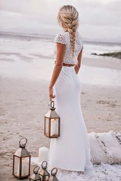 lanterns. long braid. clean white. dusk on the beach