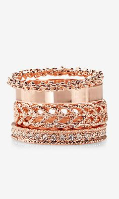four textured stackable rings
