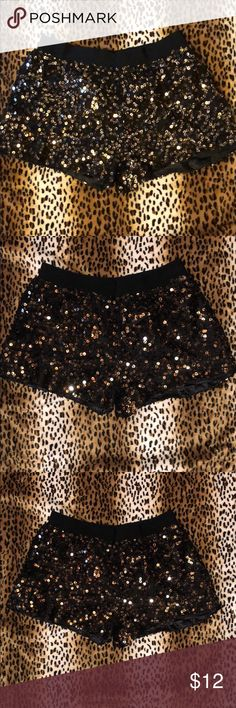 Authentic icon black silver gold sequin shorts Authentic icon sequin black gold silver shorts  Please check out my other listings and bundle and save Authentic Icon Shorts
