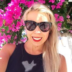 Making friends with the flowers  #flowers ##Oia #Santorini #selfie #girl #smile