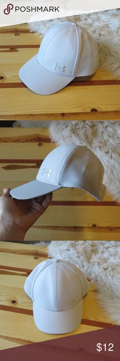 Under Armour Baseball Cap Under Armour Baseball Cap - worn once. Excellent Condition. Very light grey in color. Under Armour Accessories Hats