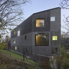 2b Architectes creates patchwork facade for concrete apartment block in Lausanne