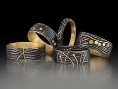 Damascus and gold rings by Victoria Moore