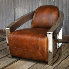 Paying homage to the 1938 Bugatti Atlantic Coupe, with its futuristic curves, chrome and leather, the Oslo pairs arms of stainless steel with a warm, vintage leather seat. Its sleek, built for speed design contrasts old and new to masterful effect. A deep seat and raked back offer considerable comfort, swathed in sumptuous leather.