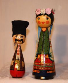 a pair of wooden dolls, Eastern European, handpainted, man 7 in tall, woman 8.5 in tall