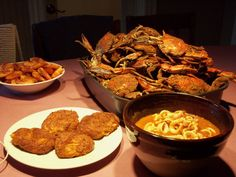steamed maryland blue crab, crab cakes, boiled shrim and calamari - Christmas Eve Dinner = seafood delight!