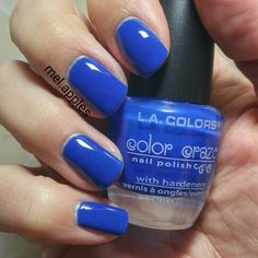 L.A. Colors Color Craze - Navy CNP620. Deep blue cream. 3 coats. Photo shows with topcoat but this color is very shiny without topcoat. Formula is very smooth after the first coat and holy cow is this richly pigmented!