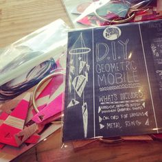 Fluorescent pink mobiles kits by The Society of National Industry. Drool-worthy. Available at Ugly Baby and La Ru.