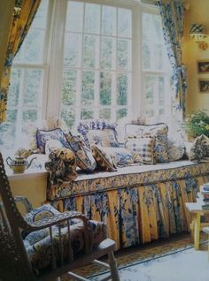 French Country. Something very appealing about the fabrics and design here.