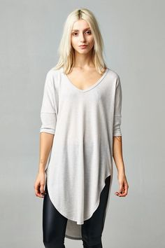 FashionGo   Cherish   T14425 Loose fit, three-quarter length dolman sleeve, scoop v-neck tunic top. Has dropped shoulder. Rounded hi-low hems. This tunic top is made with brushed hacci fabric that has a very soft fuzzy texture, has great drape, and is very warm. Fabric:75% Rayon, 21% Polyester, 4% Spandex Made In:U.S.A