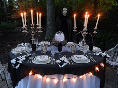A Perfect Setting: Ghoulish. This is probably the best Halloween table I've ever seen, and it's outdoors. Check out all the details and surrounding decor, bar station, etc on the website.