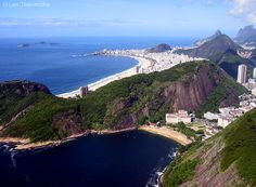 Looking down on Rio and Copacabana beach from the summit of Sugar Loaf. For more images from Rio , visit: http://flyseestay.com/see/rio-de-janeiro-brazil-photo-essay/ #Landscapes