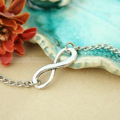 Infinity bracelet everlasting lover karma enternity by mosnos on Wanelo