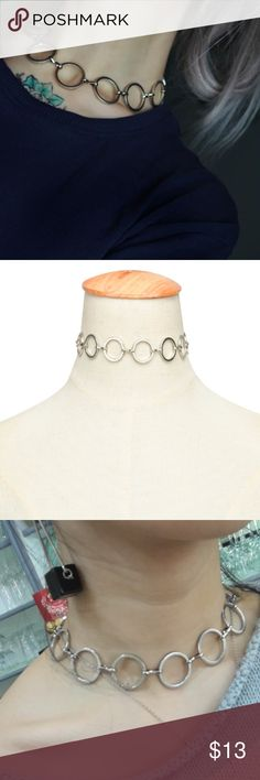 NEW Silver Circle Chain Reaction Choker Brand new in package! Stylish silver colored choker with circles linked up together. Has a clasp on the back that is adjustable. Very chic! Would be  perfect for a night out with a little black dress! Reminds me of a similar style to UNIF or dolls kill. Made out of zinc alloy metal. Length: 30+7cm Jewelry Necklaces