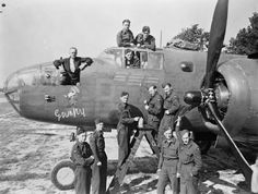 Ground personnel of No 98 Squadron RAF, who serviced the North American B25 Mitchell Bomber. On the nose is a Grumpy insignia