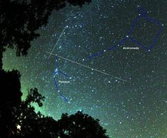 In this photo, two Perseid meteors streak across the sky, detailed to indicate how both shooting stars appear to have originated just above and to the viewer's left of the constellation Perseus, from whence the meteors get their name.