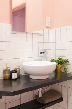 This pink bathroom with gold accents was a big hit! The simple white subway tiles are laid in an interesting pattern to create a fresh new look. Best Bathroom Tiles, Bathroom Tile Designs, Bathroom Flooring, Bathroom Plants, Pink Tiles, White Subway Tiles, Downstairs Loo, Apartment Projects, Kitchen
