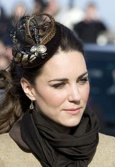For Prince William and Kate Middleton's first official public visit (to Anglesey) after announcing their engagement, the soon-to-be royal bride wowed in a clever fascinator complete with feathers and a decorative fleur-de-lis symbol.