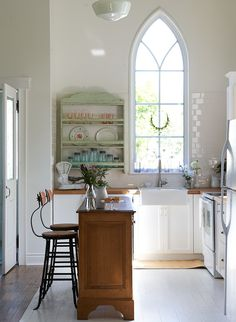 The kitchen is a bit small, but the style is decent, and I like the cathedral window.