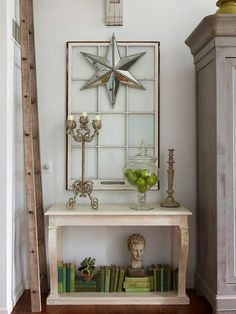 Get Creative              Two otherwise ordinary antique windows combined with a metal star find new life as unusual artwork in the living room. When working with antiques, balance and scale are crucial to creating an eye-catching display. Here, the slender height of the ladder and the antique corbel affixed to the wall offset the weight of the French armoire
