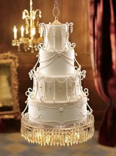 Wedding cake inspired by a vintage chandelier & this cake floats--it's suspended from the ceiling!