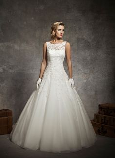 Justin Alexander wedding dresses style 8630 Sabrina sleeveless alencon lace neckline, lace drop waist, circular cut tulle with floating appliques, v back neckline, with buttons over back zipper, chapel length train.