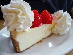 classic cheesecake with whipped creme and strawberrys