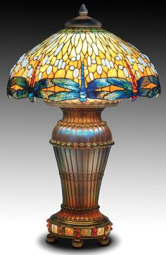 TIFFANY STUDIOS Early, possibly unique oversized table lamp with a leaded-glass Dragonfly shade over a spectacular Favrile glass Moorish base accentuated with delicate ropes and jewels, six ball feet and a cluster of six sockets. Antique Lamps, Antique Lighting, Vintage Lamps, Tiffany Art, Tiffany Glass, Stained Glass Lamps, Leaded Glass, Glass Chandelier, Pendant Lamps