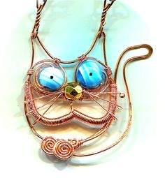 WireWorkers Guild: How to make a wire cat (and owl).  #Wire #Jewelry #Tutorials