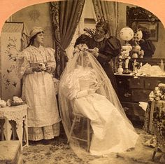 Vintage Photography: Dressing the Bride (it looks like she's texting, but that can't be...lol)
