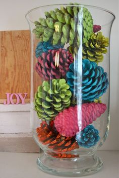 {DIY Colored Pinecones} Put paint in tall, tight sealing container, add 1-2 Tbls. water. Add pinecone, seal, shake. Use tongs to remove, let excess drip off. Let dry on newspapers laying on side so paint can dip off.
