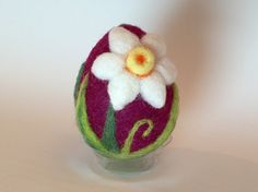 This needle felted egg is the size of a real egg. Approximately 2  Made of deep purple wool with two white and yellow daffodils. Great addition to an Easter collection. Firmly felted. Crafted in a smoke free home. Thanks for looking