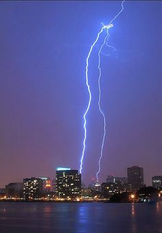 "Taken from Lake Merritt:  A lightning bolt strikes over downtown Oakland on April 12, 2012. From Damon Tighe: ""Great storm over Oakland. Most of the bolts were at my back, but I was lucky to get one striking right where I was hoping it would: over downtown!""   Photo: Damon Tighe / Courtesy photo"