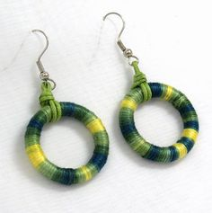 wrap embroidery thread around any kind of small hoop (wood possibly) and fasten to earing hooks
