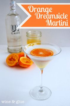Orange Dreamsicle Martini with Orange Infused Simple Syrup. The Orange Dreamsicle taste you loved as a kid all grown up! | Orange Dreamsicle Martini from Wine & Glue #orange #dreamsicle #cake #vodka #cocktail