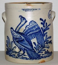 SOLD - $ 72,600 March 2007 N. . CLARK & CO ROCHESTER, NY 6 gallon tall crock.  Rare and important decoration of the phoenix bird of Egyptian mythology. The painstaking detail used in the creation of this design gives it a three-dimensional quality. The superior skills of this Rochester decorator shown in this piece is why they are a highly sought after Folk-Art design.    Found recently in a barn in Upstate New York and has never been offered for public sale