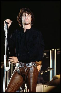 His classic brown leather pants