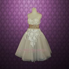 Gorgeous retro 50s inspired strapless sweetheart tea length wedding dress with floral applique and beautiful pearl beadings around the sweetheart neckline.
