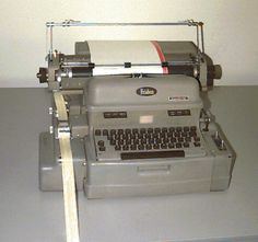 The Friden Flexo writer. There is a paper tape reader on the left and a paper tape punch in front of it. The paper tape reader read a program on a paper tape loop which controlled the tabs and carriage returns for the continuous pre-printed forms which were typed by the operator. The information (sales data) entered on the form would also be punched onto paper tape. The spools of paper tape would eventually be input to the Honeywell 400 mainframe. The CWS had two pools of approximately 100…
