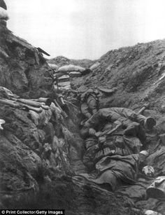 The photograph displays trench warfare during WWI. Bodies were left to wither away, and conditions were harsh.