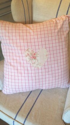 A vintage check cushion with a heart made from pretty french fabric